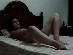 Naughty Chick Masturbating On Her Bed