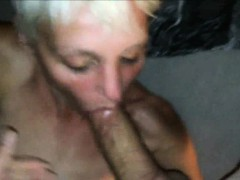 Mature blonde with short hair sucking dick