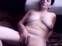 Naughty Grandma Strips And Rubs Her Pussy