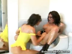 Two hot babes making out and playing dildo in the bathroom