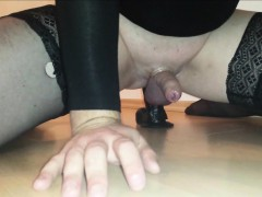 Shemale rides a big black dildo and cums