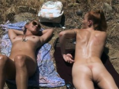 Two sexy cougars tanning while naked in the woods