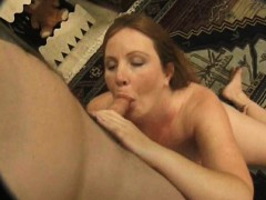 Chunky redhead wife with big breasts worships her lover's l