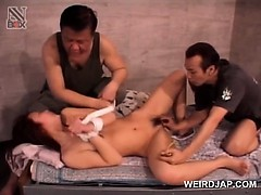 Naked asian slave in ropes pussy teased hard in 3some