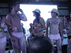 Beach party with a competition of naked people dancing and