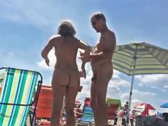 Voyeur movie of naked couple on beach