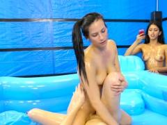 Naked lesbians wrestling in oil pool