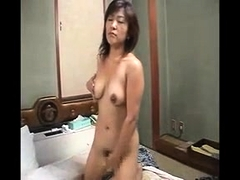 Horny asian toying her hairy pussy